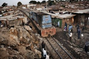 Kibera, Kenya. 6 July 2011 A train slows down as it passes through the slum.