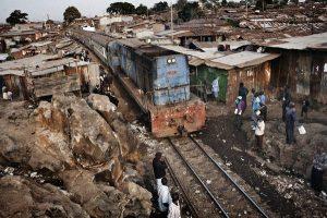 Kibera, Kenya. 6 July 2011 A train slows down as it passes through the slum.